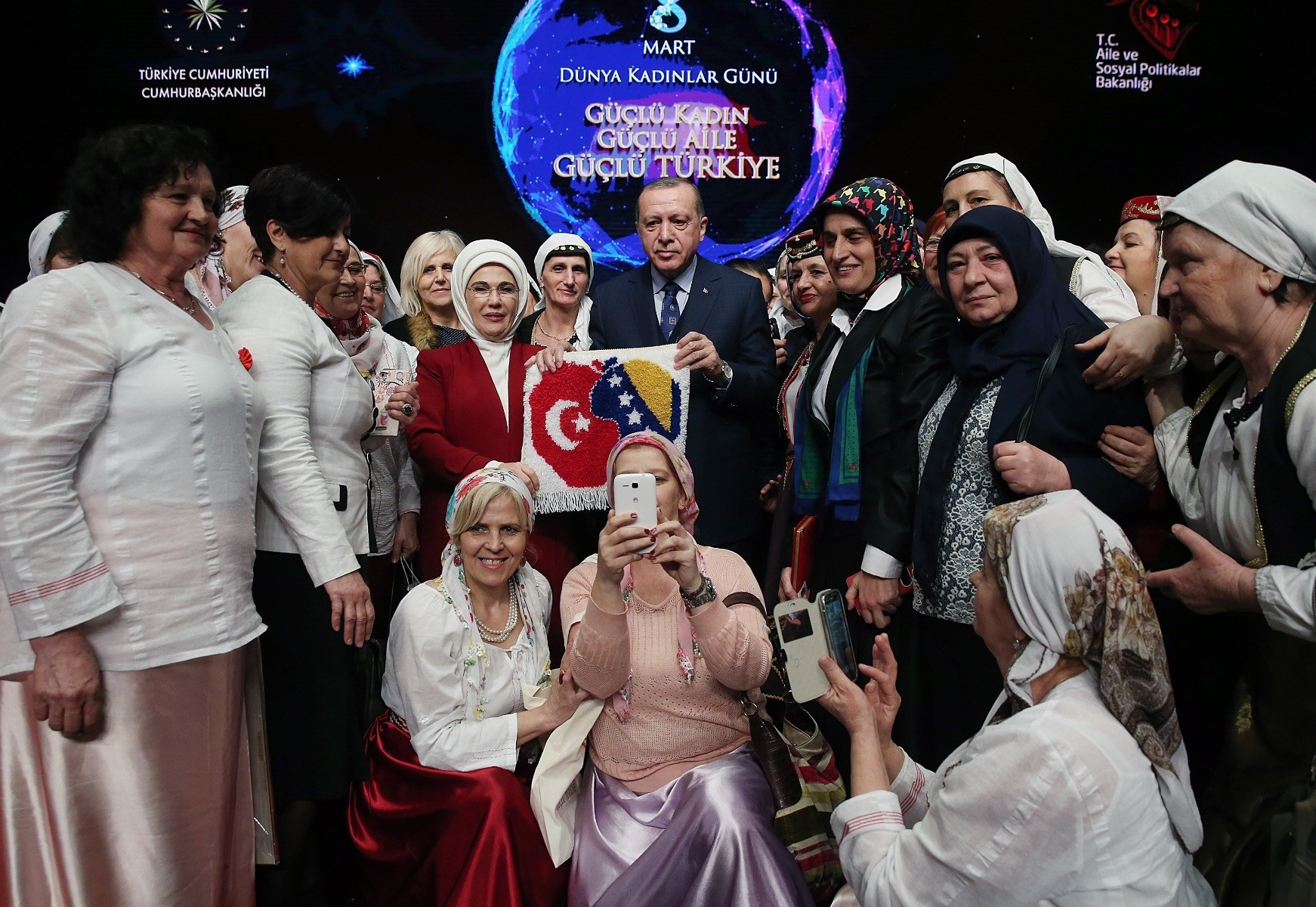 First Lady and President Erdou011fan poses with women on the sidelines of the event held at the Presidential Complex.
