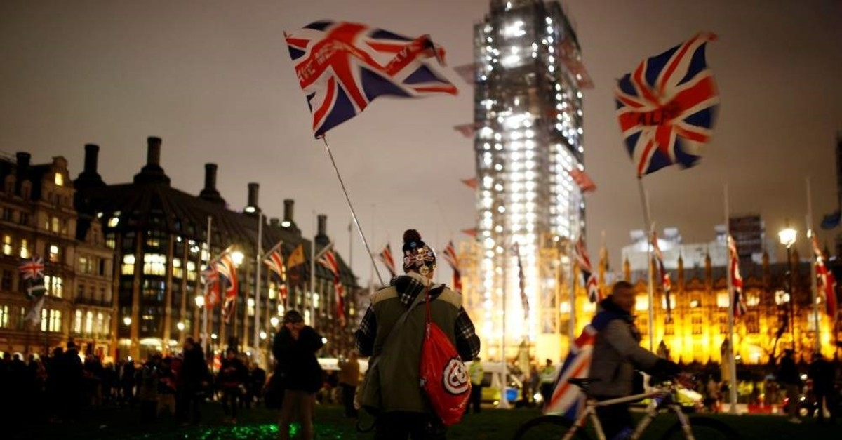People celebrate Britain leaving the EU on Brexit day in London, Jan. 31, 2020. (REUTERS Photo)