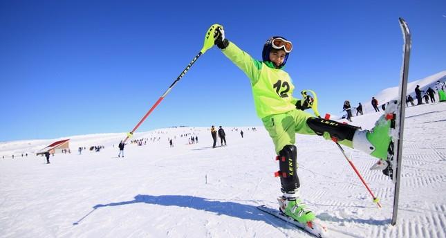 A boy enjoys his time skiing during semester break.