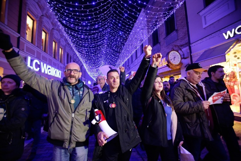 Davor Dragicevic, second left, walks during a peaceful protest march in the Bosnian town of Banja Luka, 240 kms northwest of Sarajevo, Bosnia, on Wednesday, Dec. 26, 2018.