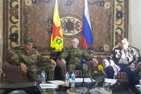 Russian general poses in front of YPG flag as terrorist group declares Daesh's defeat in Deir el-Zour