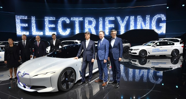 The BMW board pose for a photo at a BMW event during the first media day of the International Frankfurt Motor Show IAA in Frankfurt, which runs through Sept. 24, 2017.