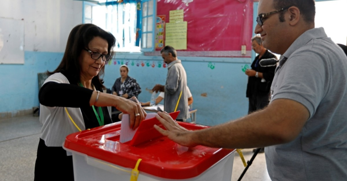 A woman casts her ballot at a polling station during parliamentary elections, in Tunis, Tunisia October 6, 2019. (Reuters Photo)