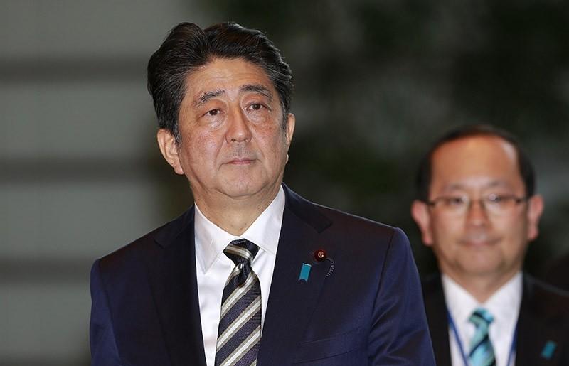 Japan's Prime Minister Shinzo Abe, left, arrives at his official residence in Tokyo, Wednesday, Nov. 1, 2017. (AP Photo)