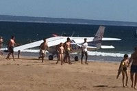 Light aircraft crash-lands on packed beach in Portugal, kills 2