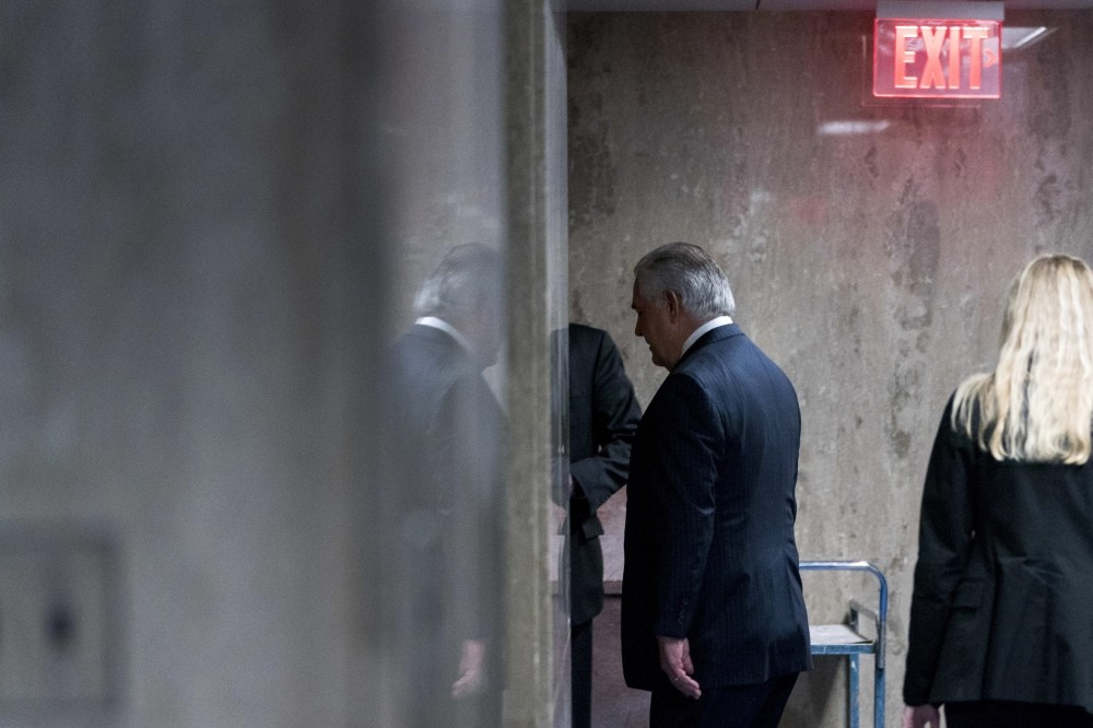 Recenty sacked U.S. Secretary of State Rex Tillerson walks down a hallway after speaking at a news conference at the State Department in Washington, March 13.