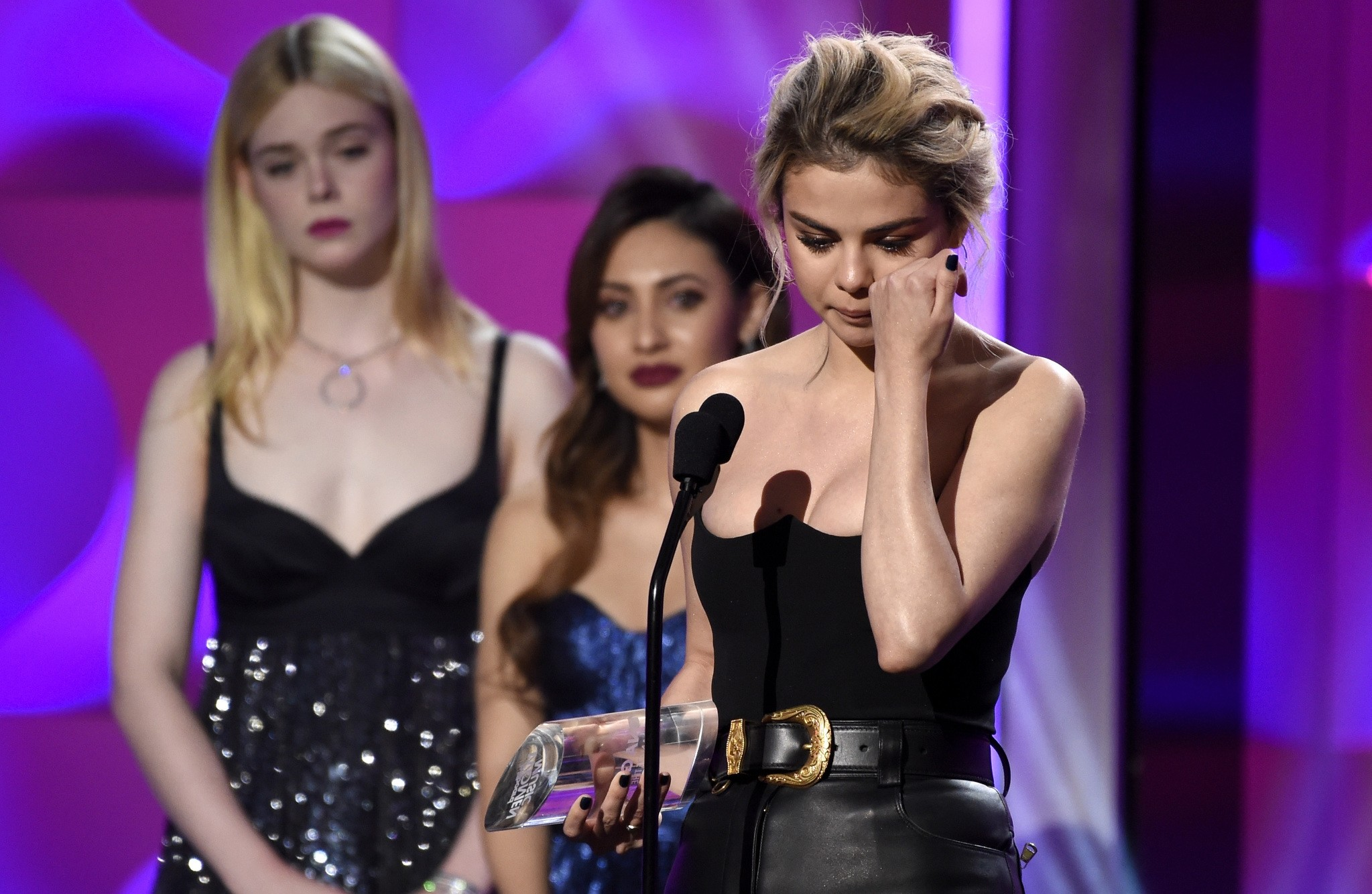 Selena Gomez wipes a tear as she accepts the woman of the year award at the Billboard Women in Music event at the Ray Dolby Ballroom on Thursday, Nov. 30, 2017, in Los Angeles. (AP Photo)