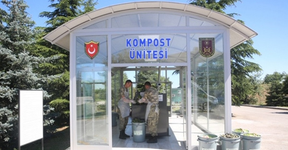 Soldiers dispose of waste at the compost unit in this undated photo provided by the Ministry of National Defense
