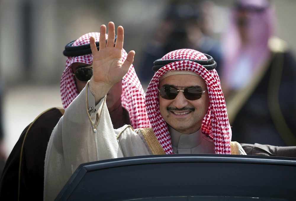 Saudi billionaire Prince Alwaleed bin Talal, waves as he arrives at the headquarters of Palestinian President Mahmoud Abbas in the West Bank city of Ramallah. (AP Photo)