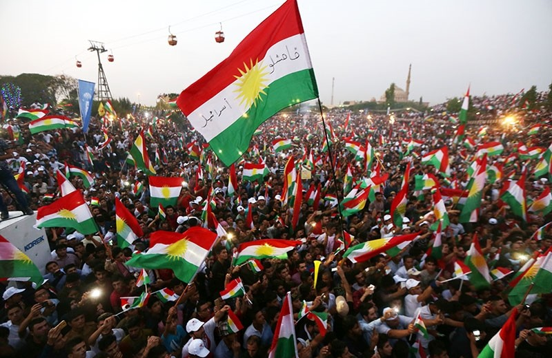 Iraqi Kurds fly Kurdistan Regional Government flags during an event to urge people to vote in the upcoming independence referendum in Arbil, the capital of the autonomous Kurdish region of northern Iraq, on Sept. 16, 2017. (AFP Photo)