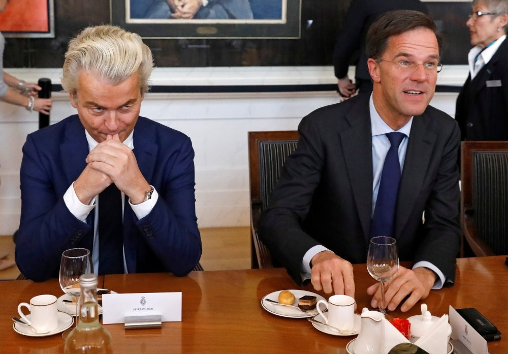 Prime Minister Mark Rutte (R) and far right politician Geert Wilders taking part in a meeting in the Dutch Parliament after the general election in The Hague, Netherlands, March 16.