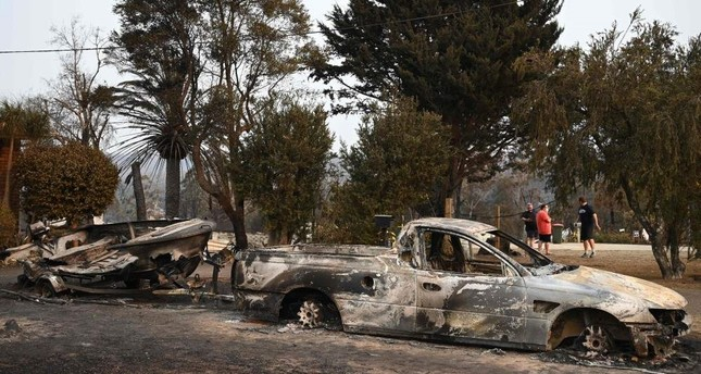 Vehicles gutted by bushfires are seen in the town of Lake Conjola, New South Wales, Jan. 1, 2020. AFP Photo
