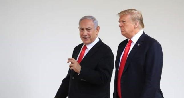 The U.S. President Donald Trump and Israeli Prime Minister Benjamin Netanyahu walk along the Colonnade of the White House, Washington, D.C., March 25, 2019. (AP Photo)