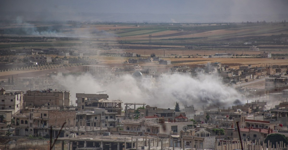 Plumes of smoke rise following reported Syrian regime forcesu2019 bombardment of the town of Khan Sheikhun in the southern countryside of Idlib province, June 5, 2019.