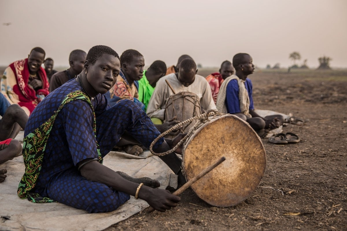 Cattle herders gather for church prayers. The sacrificing of oxen has traditionally been a central component of Dinka religious practice.