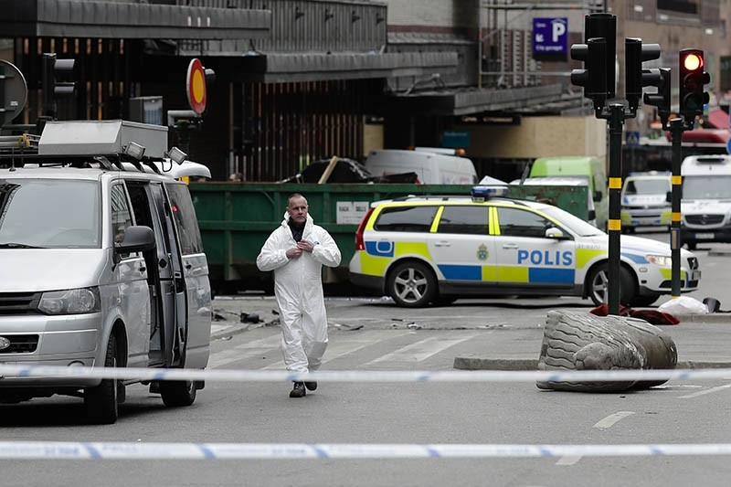 A street is cordoned off near the department store Ahlens following Friday's suspected terror attack in central Stockholm, Sweden, Saturday, April 8, 2017 (AP Photo)