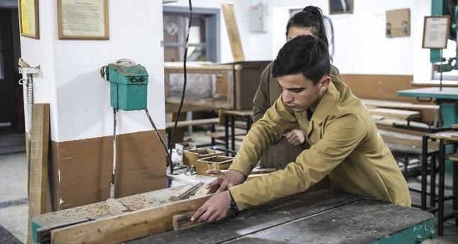 Students build desks for 150 schools in Afrin.