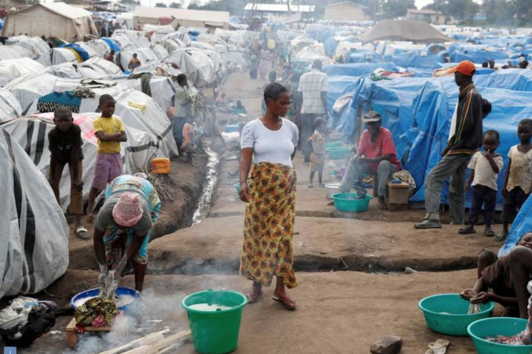 A woman walks at an internally displaced persons (IDP) camp in Bunia, eastern Democratic Republic of Congo, April 12.