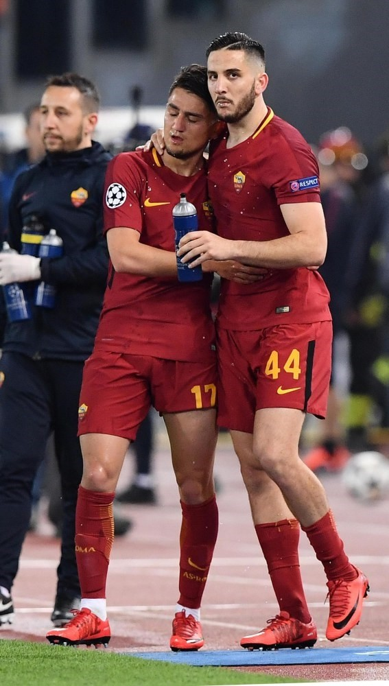 Roma's Kostas Manolas (R) celebrates with teammate Cengiz u00dcnder after scoring the key third goal during the UEFA Champions League quarter final second leg match at the Olimpico Stadium in Rome.