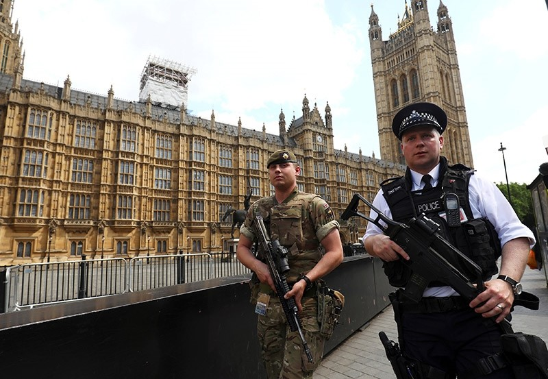 soldier and police officer walk past the Houses of Parliament in London, Britain, May 24, 2017. (Reuters Photo)