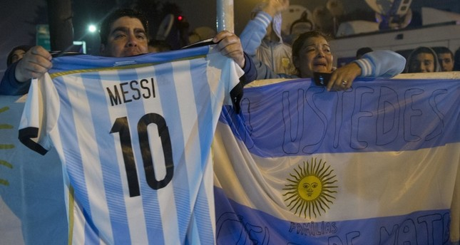 Fans gathered outside the downtown office of the Argentine Football Association, many torn by Messi's promised departure.