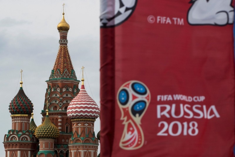 A flag with the logo of the World Cup 2018 on display with the St. Basil's Cathedral in the background, in Moscow, Russia, Monday, June 4, 2018. (AP Photo)