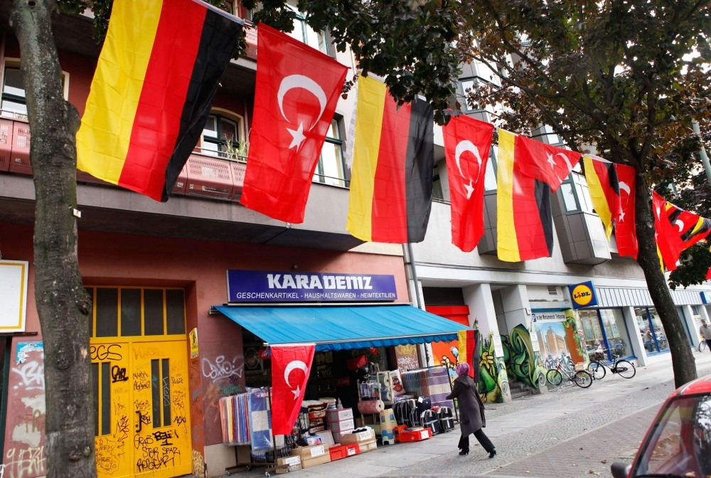 A shopkeeper in Kreuzberg, a district with a large Turkish population, has German and Turkish flags outside his shop.