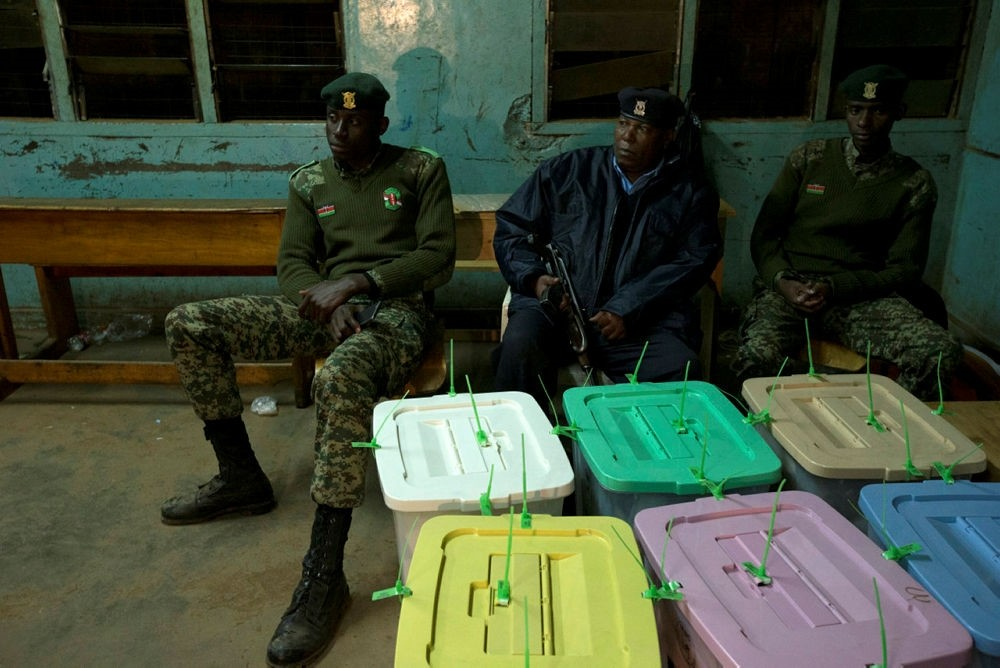 Ballot boxes are guarded by an armed policeman at a polling station in Kibera in the capital Nairobi, Kenya, 08 August 2017. (EPA Photo)