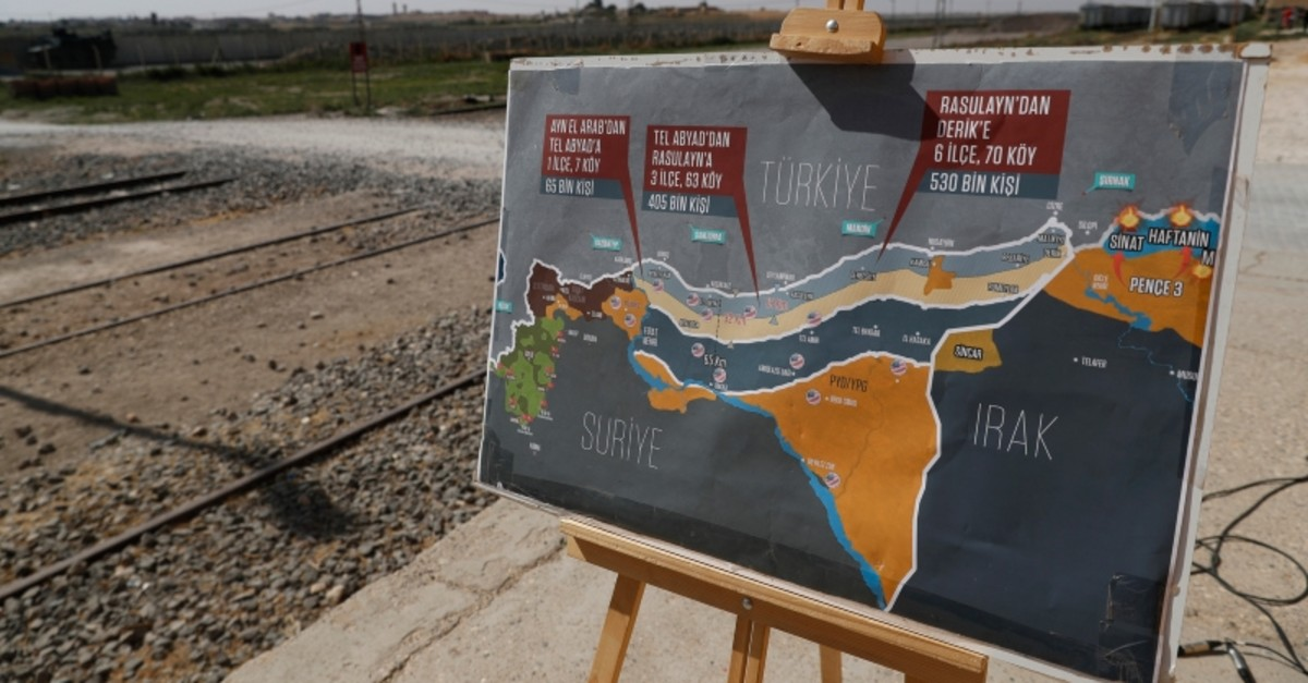 A map showing Turkey's suggested possible operation in Syria, used by a TV journalist is seen at the border between Turkey and Syria, in Akcakale, u015eanlu0131urfa province, southeastern Turkey, Tuesday, Oct. 8, 2019 (AP Photo)