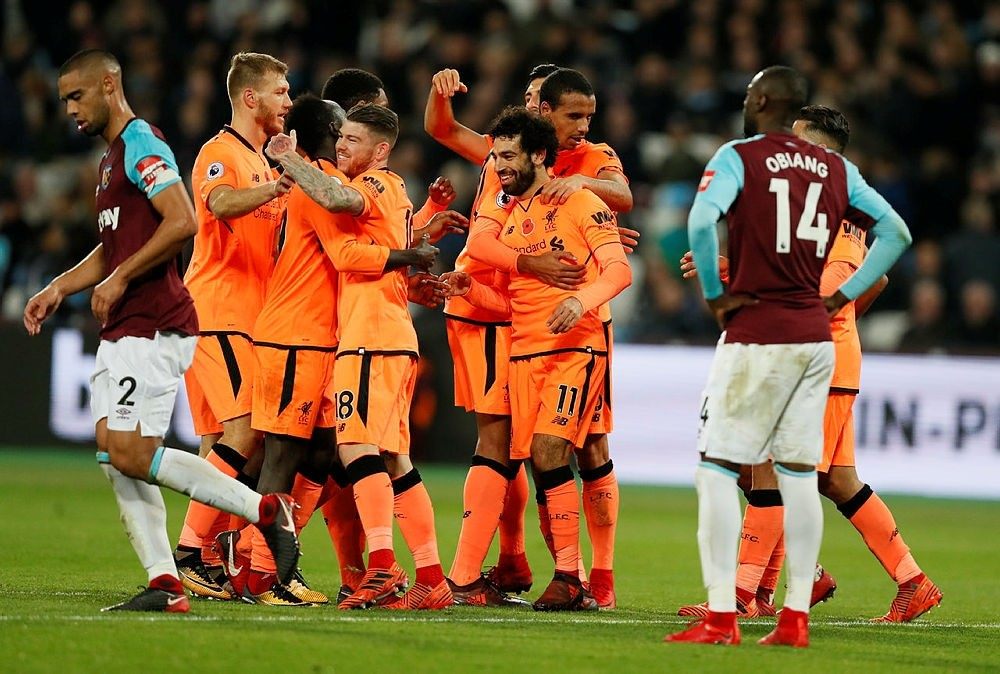 Liverpool's Mohamed Salah celebrates with teammates after scoring his side's fourth goal past West Ham in London, Saturday, Nov. 4, 2017. (AP Photo)