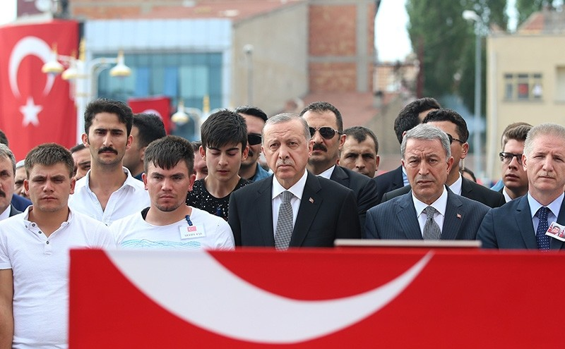 President Recep Tayyip Erdou011fan attends funeral for wife and baby of Turkish soldier killed by PKK terrorists. (AA Photo)