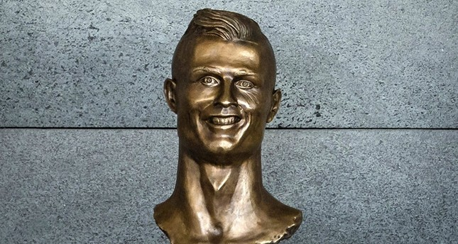 Airport renamed in Ronaldo honor, 'bizarre' bust steals the show at ceremony