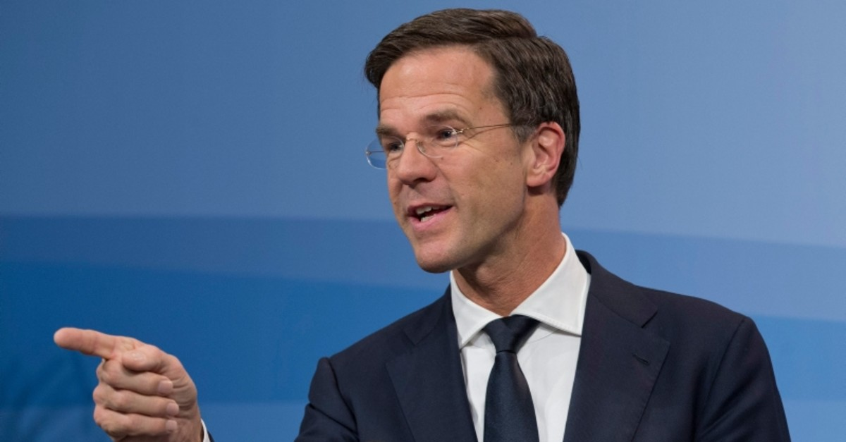 Dutch Prime Minister Mark Rutte explains the cabinet decision to extend its campaign to extend Dutch air strikes from Iraq into Eastern Syria during a press conference after a cabinet meeting in The Hague, Netherlands, Friday, Jan. 29, 2016. (AP)