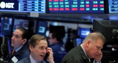 Dollar slides, yields slip, stocks steady after Fed meeting