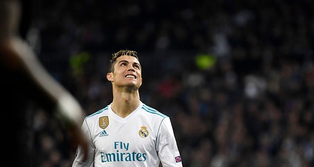 Real Madrid's Portuguese forward Cristiano Ronaldo looks upwards during the UEFA Champions League round of sixteen first leg football match Real Madrid CF (AFP Photo)