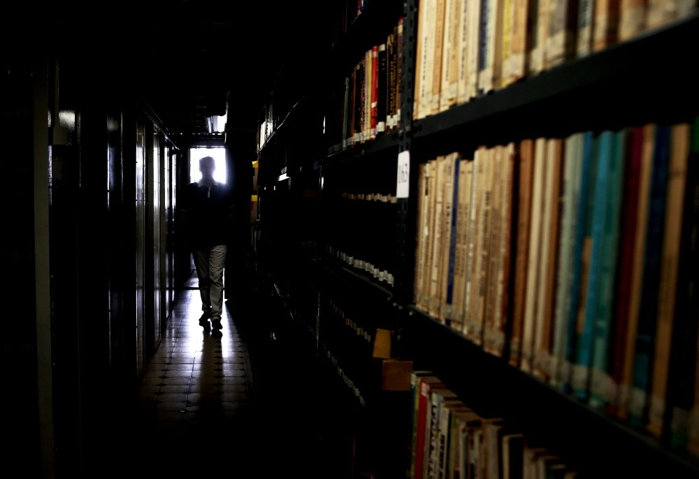A man walks amid the bookshelves in a National Library in u0130zmir, Turkey, July 27.