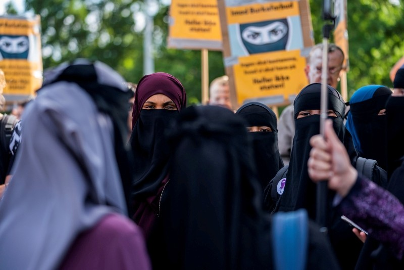 The group ,Kvinder i Dialog, takes part in demonstration against the first fine given for wearing the face veil, niqab, in Copenhagen, Denmark August 10, 2018. (Reuters Photo)