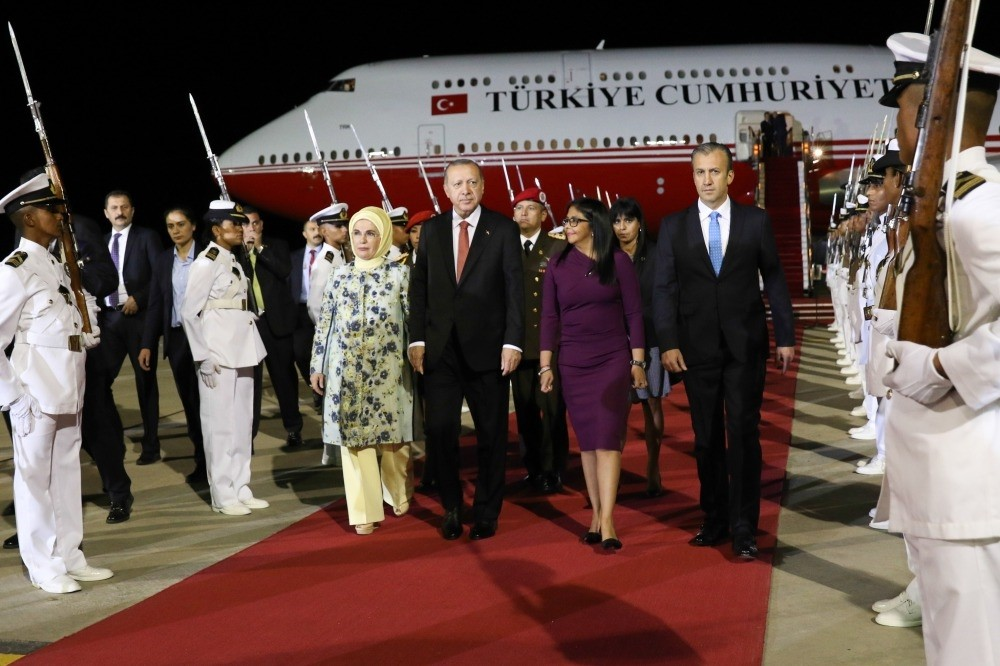 President Recep Tayyip Erdou011fan and his wife Emine Erdou011fan being welcomed by Venezuelan VP Delcy Rodriguez (second right) and Industries and National Production Minister Tareck El Aissami (right) at Simon Bolivar Airport in Caracas, late on Dec. 2.