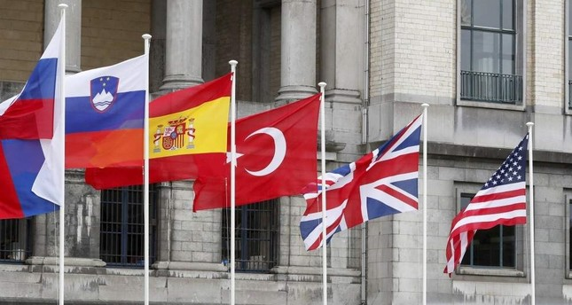 Flags of some of NATO member countries are seen outside the Cinquantenaire, Brussels. Reuters File Photo