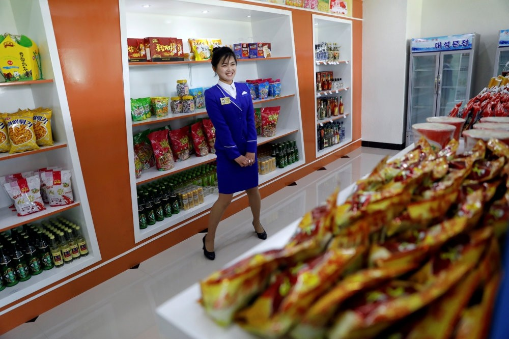 A vendor is pictured in a shop in a newly constructed residential complex after its opening ceremony in Ryomyong street in Pyongyang, North Korea.