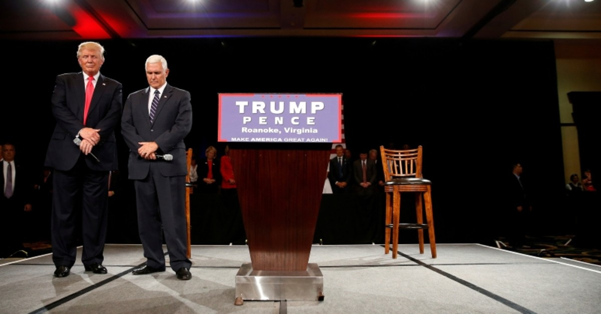 Republican presidential candidate Donald Trump (L) and vice presidential candidate Mike Pence pray at a campaign event in Roanoke, Virginia, U.S., July 25, 2016. (Reuters Photo)
