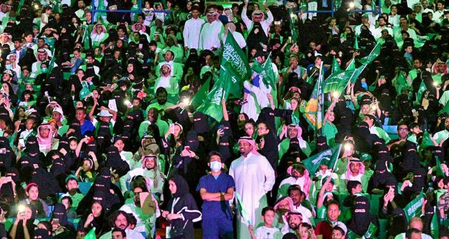 In this Sept. 23, 2017 file photo released by Saudi Press Agency, SPA, Saudi men and wom   en attend national day ceremonies at the King Fahd stadium in Riyadh, Saudi Arabia (AP File Photo)