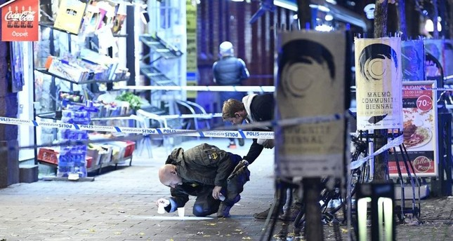 A policeman works near the scene of a shooting, Malmo, Nov. 9, 2019. (AP Photo)