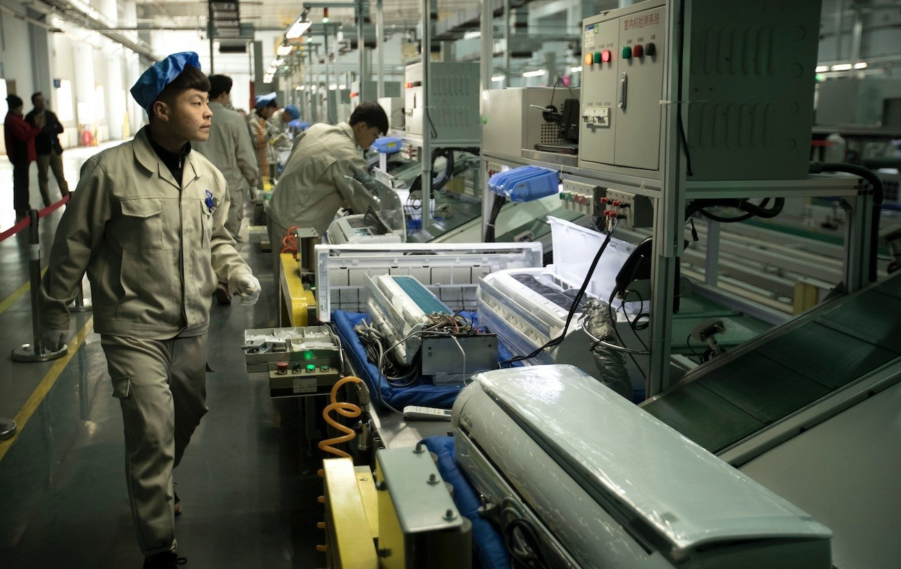 Factory workers check air conditioners on an assembly line at a Haier factory in Jiaozhou near Qingdao in the eastern Chinau2019s Shandong Province.