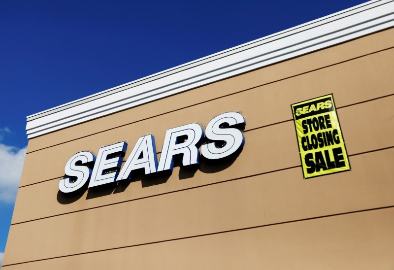 A store closing sale sign is posted next to a Sears logo in New Hyde Park, New York, U.S., October 10, 2018. (Reuters Photo)
