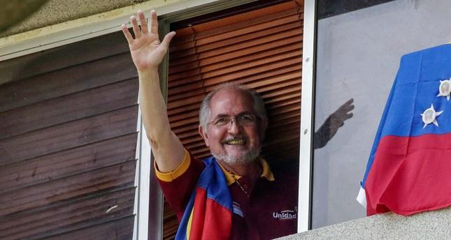 Antonio Ledezma, Metropolitan Mayor of Caracas, waves from a window of his residence in Caracas, Venezuela, 16 July 2017 (EPA File Photo)