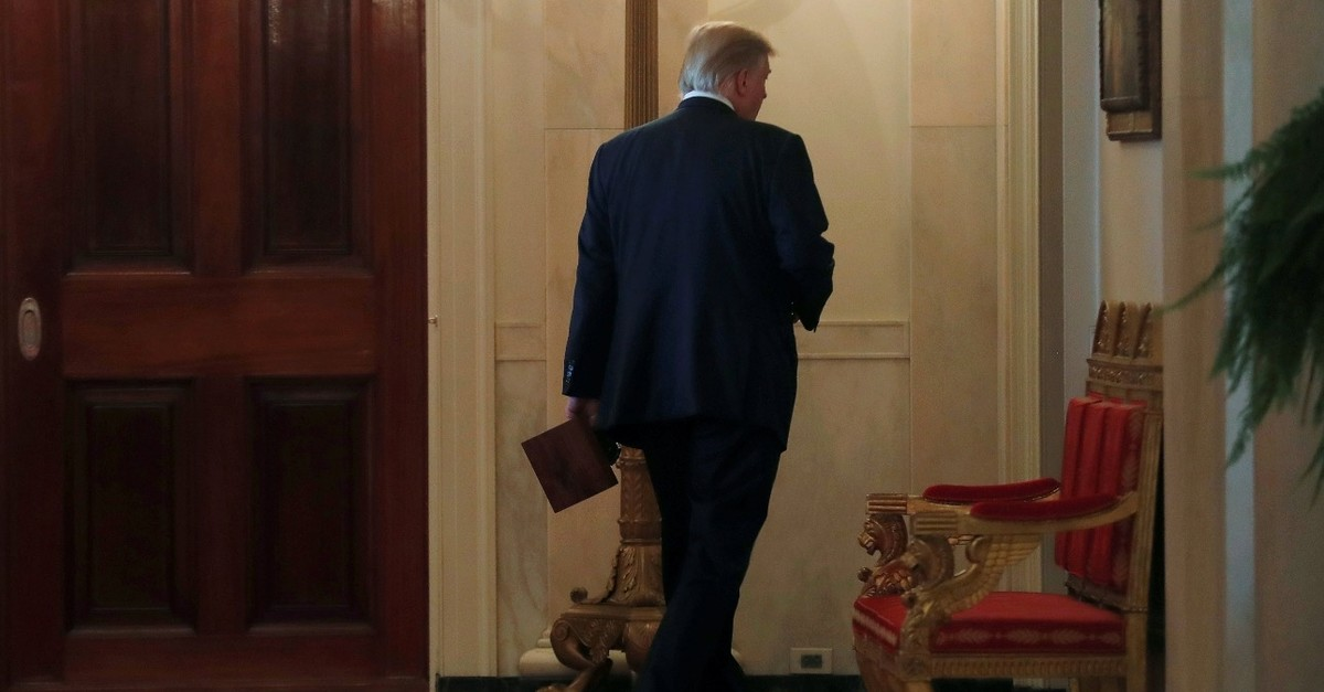 U.S. President Donald Trump walks down a hallway after hosting an event after the release of Special Counsel Robert Muelleru2019s report, in the White House in Washington D.C., April 18, 2019.