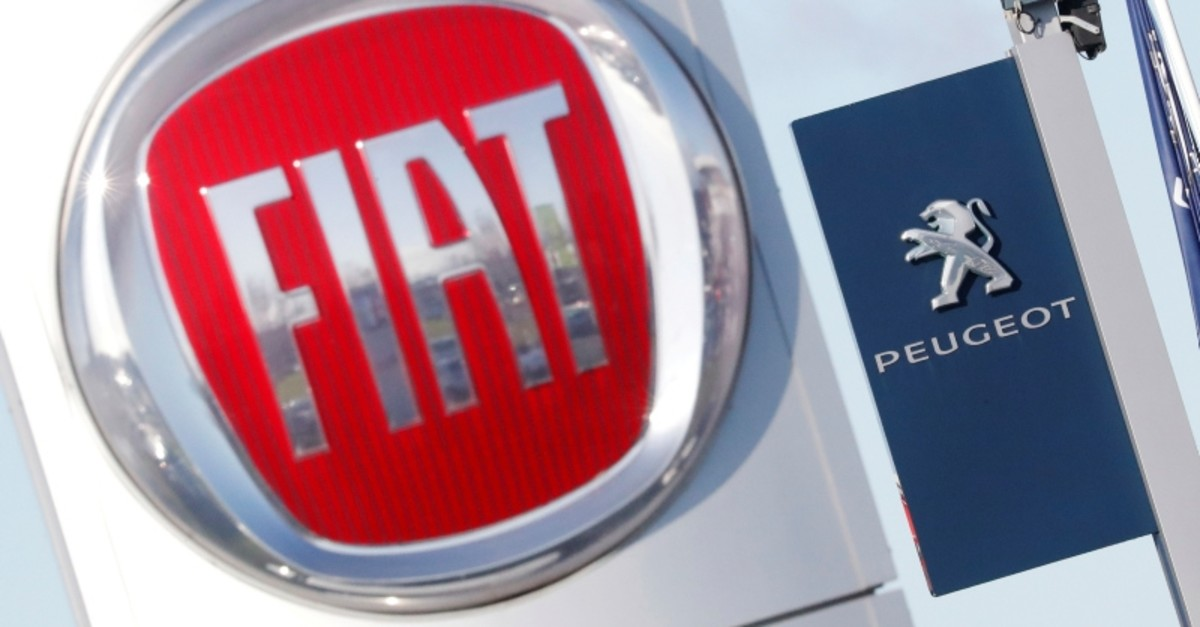 The logos of car manufacturers Fiat and Peugeot are seen in front of dealerships of the companies in Saint-Nazaire, France, Nov. 8, 2019. (Reuters Photo)