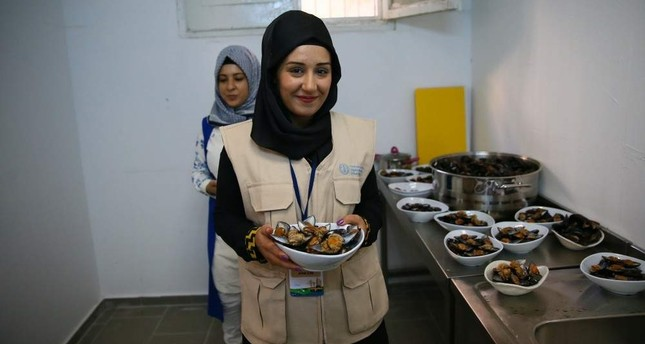 Ten Syrian and 10 Turkish women founded the cooperative that runs the stuffed mussel facility. AA Photo