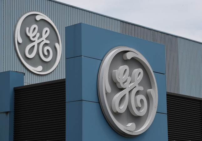 The logo of US giant General Electric is pictured as French Economy and Finance Minister Bruno Le Maire takes part to a meeting with managers and unions at the GE headquarter in Belfort, eastern France (AFP Photo)